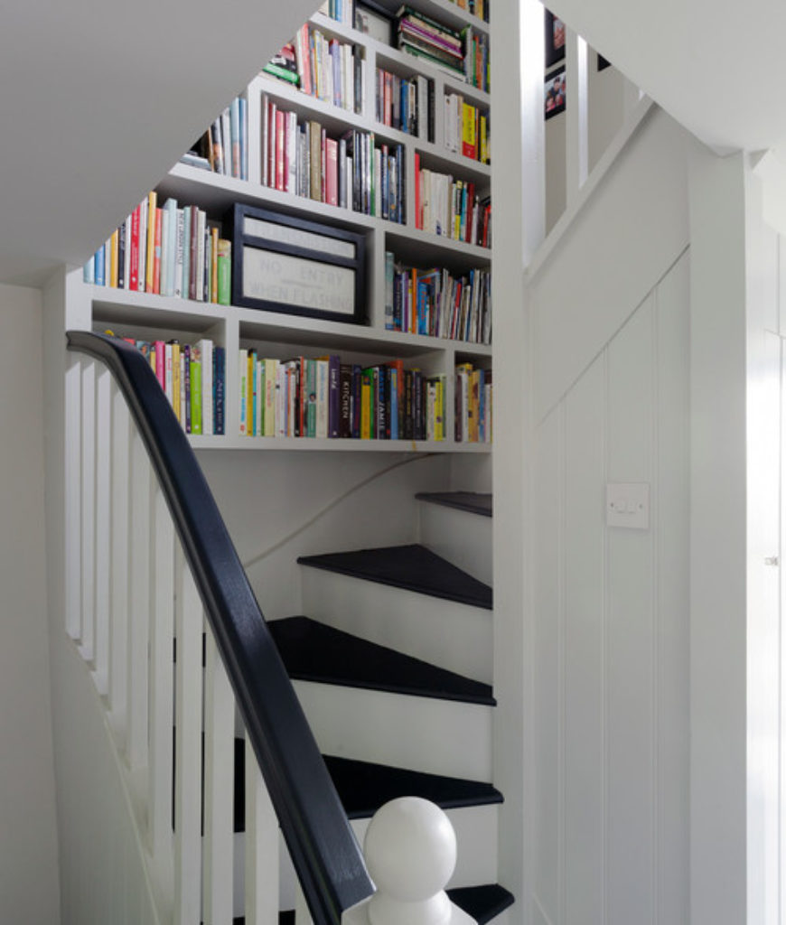 Farmhouse staircase with built-in shelf.