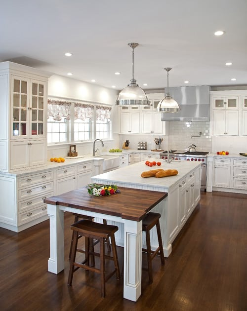 Traditional kitchen with pendant and recessed lights and hardwood floor.
