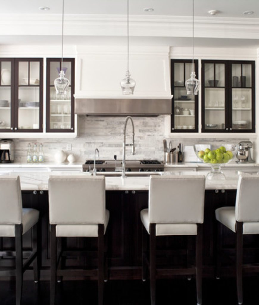 Transitional kitchen with island and four white chairs.