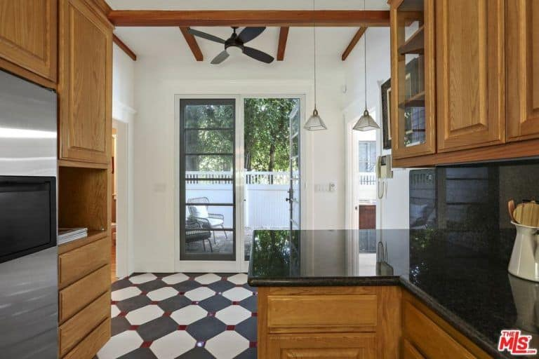 Another look of the kitchen focuses mainly on the beautiful granite countertop and the stainless steel appliance.
