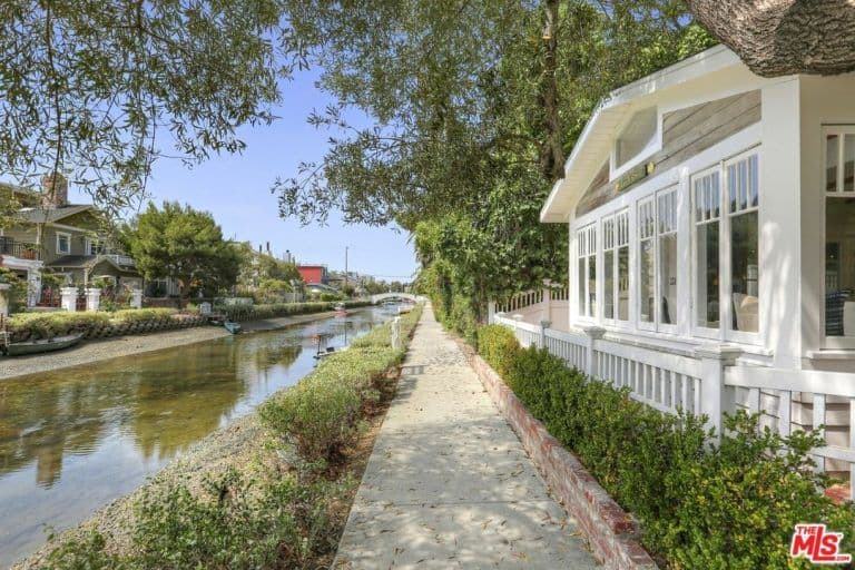 The walkway beside the home and the canal could be perfect for a morning walk.