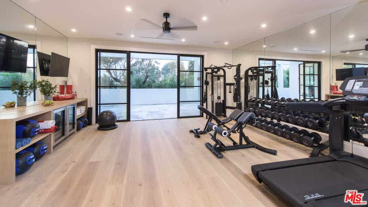 the home gym keeps the king in shape featuring a complete set of machines and equipment that the basketball star need the hardwood flooring and and regular - Home Gym Design Ideas