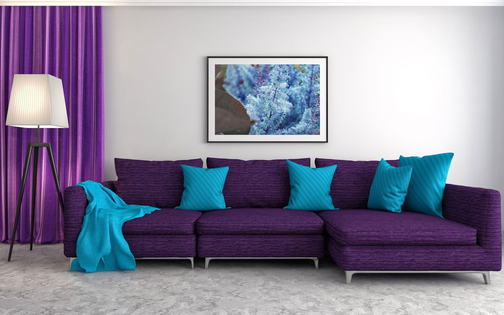 Large Purple Sectional Sofa With Blue Pillows