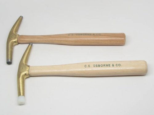 Upholstery hammer with bronze head and permanent magnet tip.