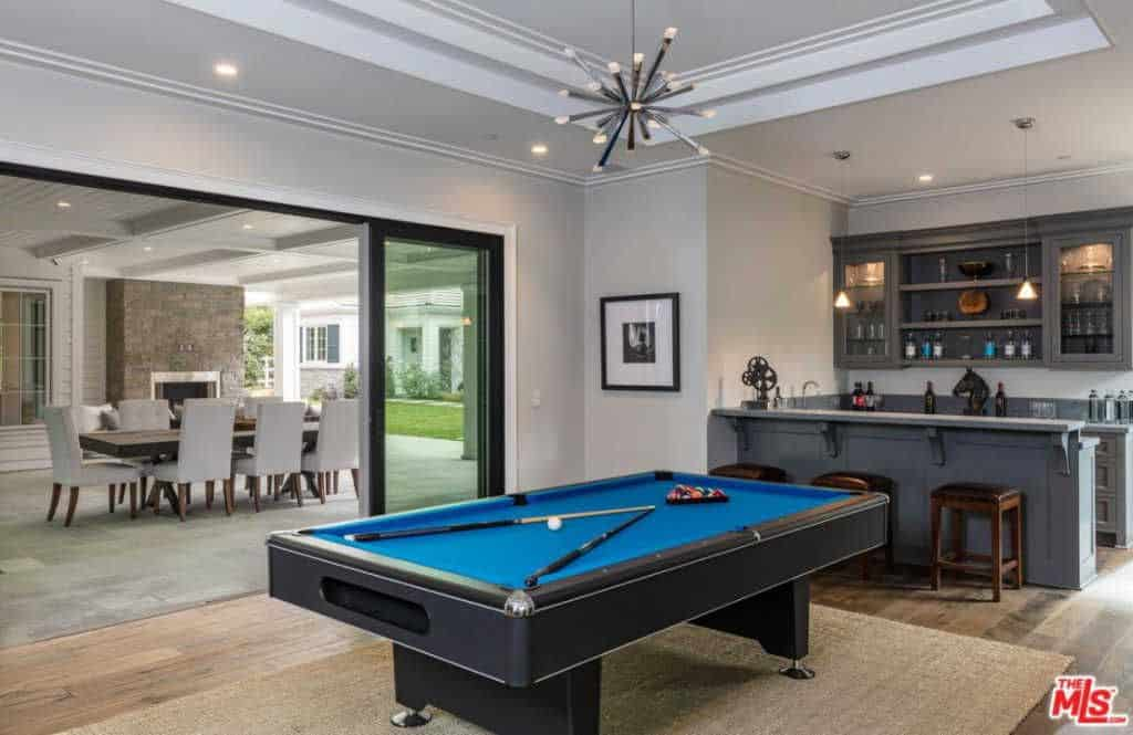 Media Room With Billiards Pool And A Bar With Pendant Lights And Rug. |  Zillow Digs