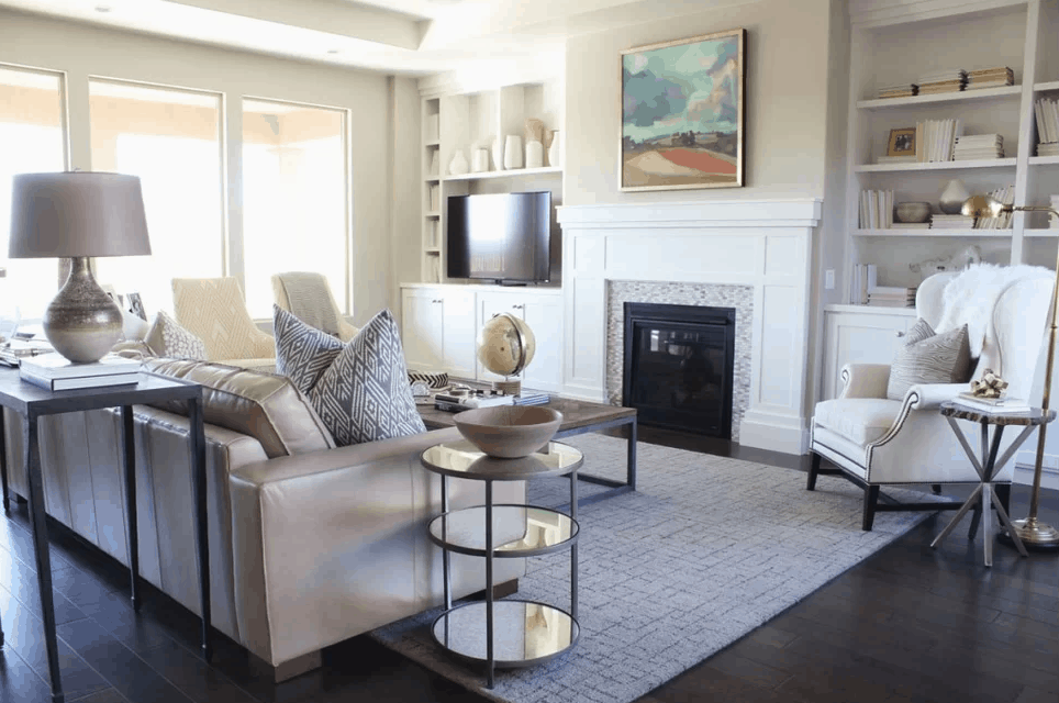 This photo gallery features a diverse set of beautiful living rooms with fireplaces. Every fireplace is a-glow with flame. Good mix of traditional and gas.