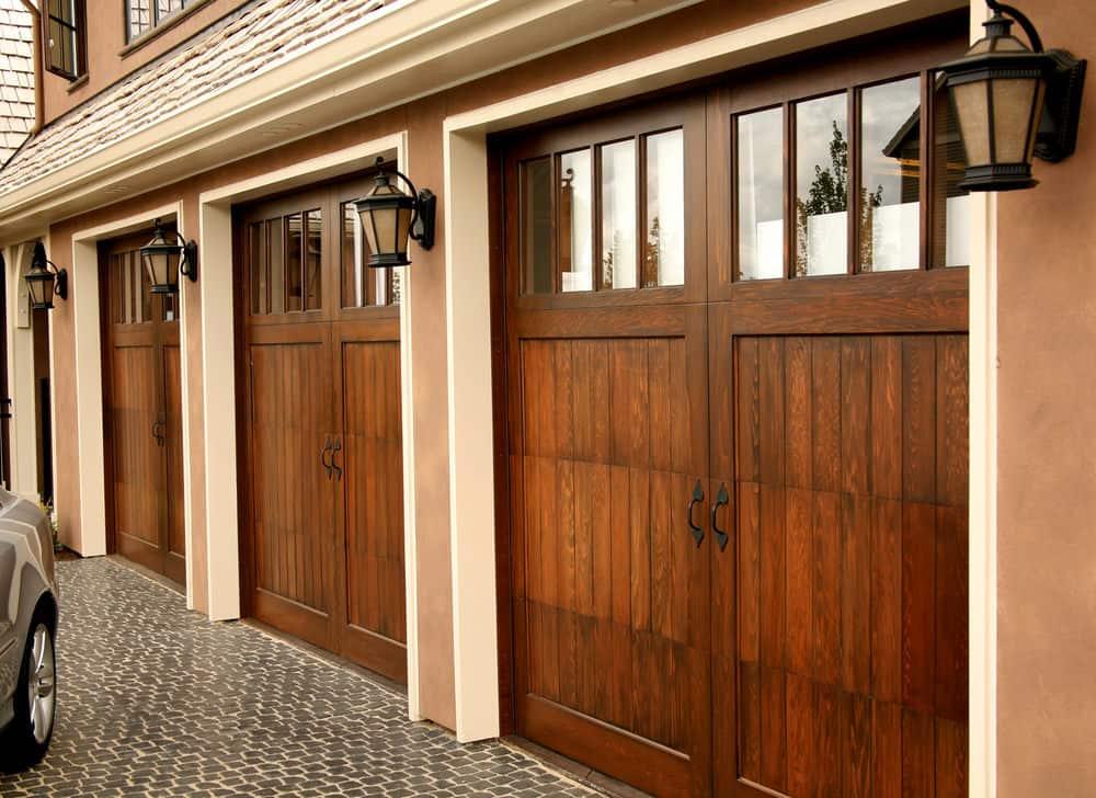 Wood garage door with upper windows in carriage style.