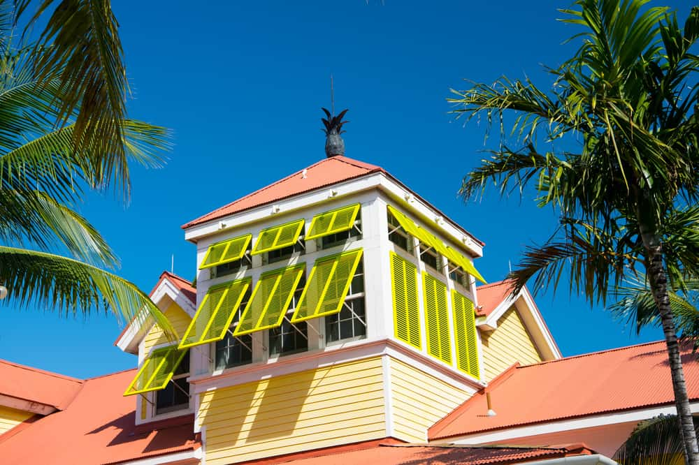 Yellow Bahama shutters on building
