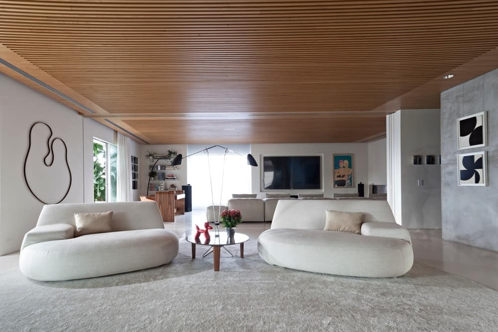 Family room featuring a seating lounge on back with regular hardwood ceiling. Photo Credit: RuiTeixeira