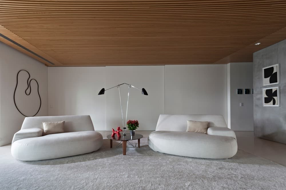 Seating lounge and family room being separated by sliding white walls. Photo Credit: RuiTeixeira