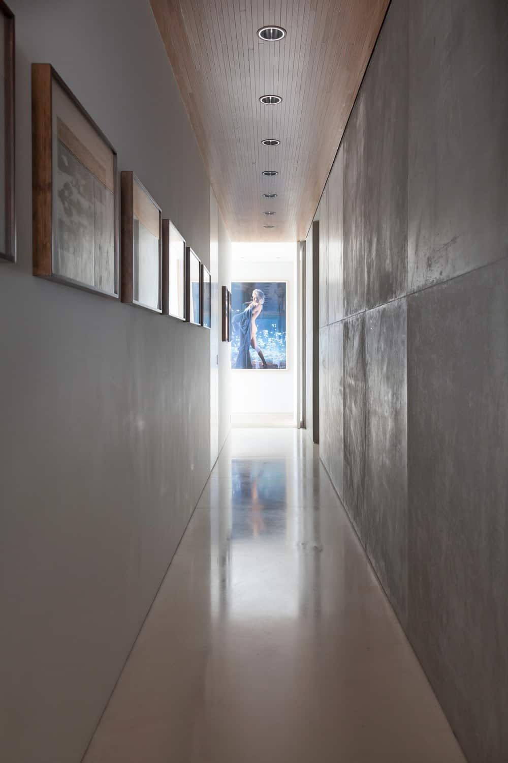 Gray hallway lighted by recessed ceiling lights. Photo Credit: RuiTeixeira
