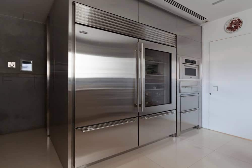Kitchen with large stainless steel appliance. Photo Credit: RuiTeixeira