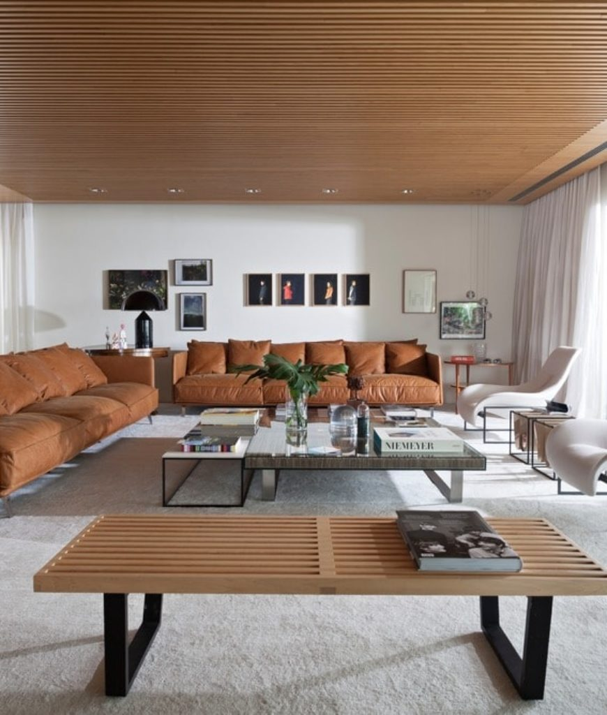 Living room with carpet flooring and white walls along with brown sofa set and hardwood regular ceiling. Photo Credit: RuiTeixeira