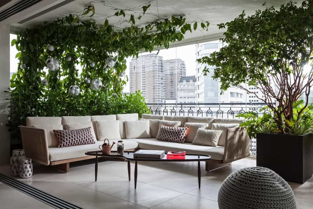A balcony patio featuring cream foam seating and indoor plants. Photo Credit: RuiTeixeira