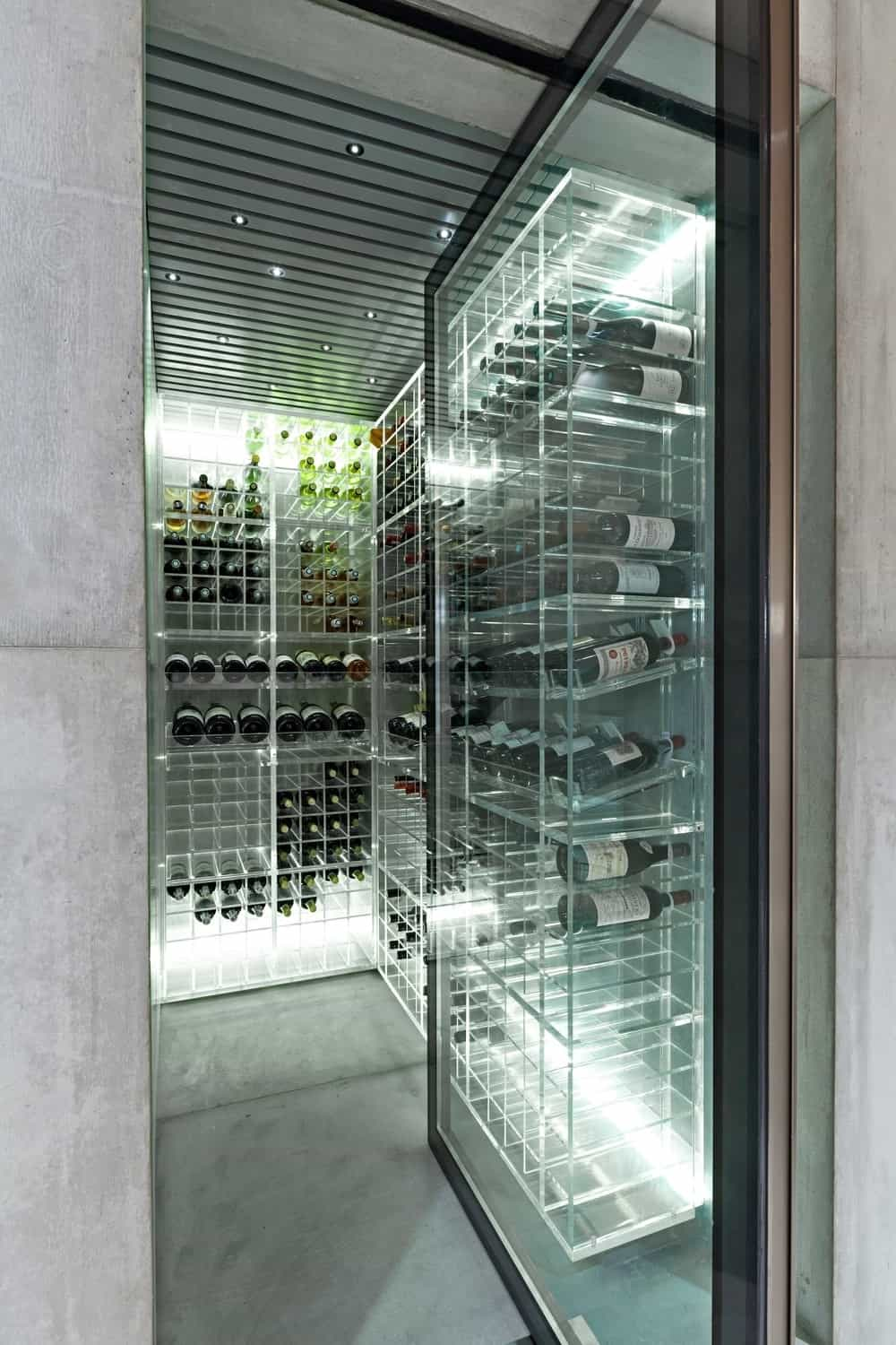 Wine cellar with glass door and wine holder. Photo Credit: RuiTeixeira