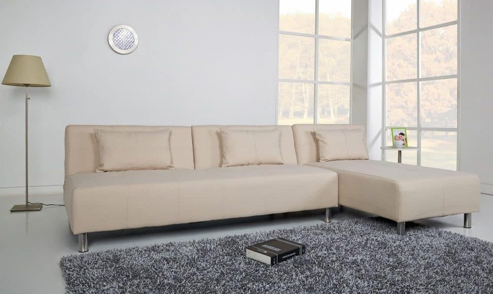 Convertible sectional sofa with leather upholstery and foam fill.