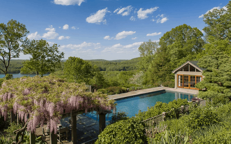 View of pool among landscaped grounds with terrific view.