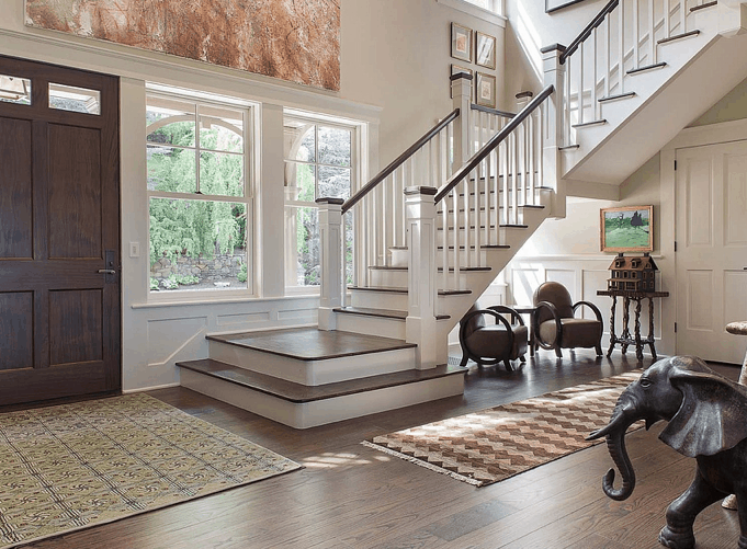 Gorgeous front entry foyer with staircase.
