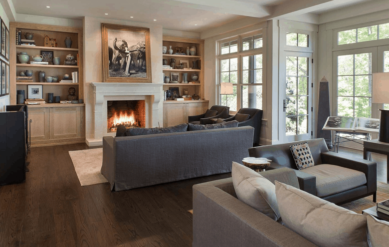 Formal living room with hardwood flooring and fireplace.