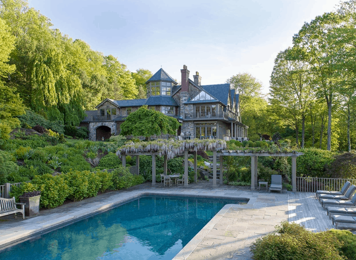 Bruce Willis' swimming pool in large landscaped yard.