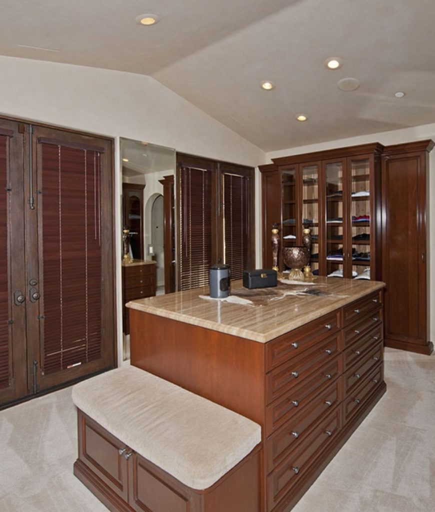The mansion also has a closet lighted by recessed ceiling lights and features a center island.