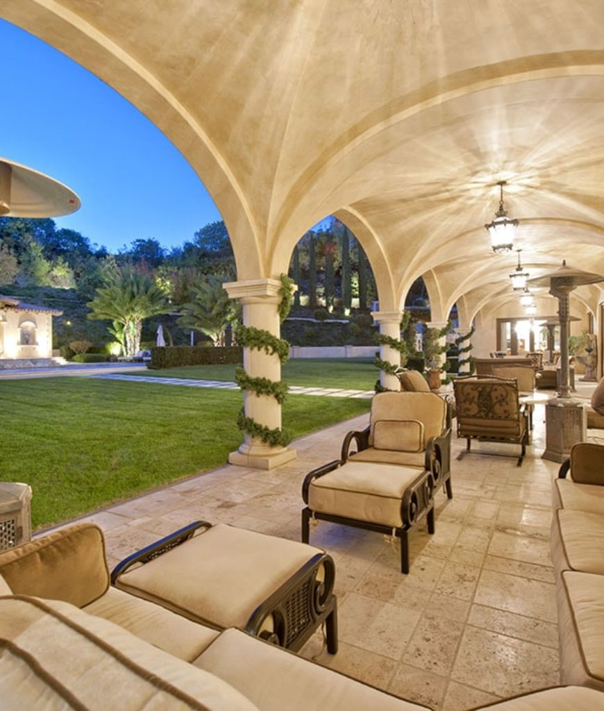 The patio just beside the garden boasts a special Italian flooring and elegant seating sections.