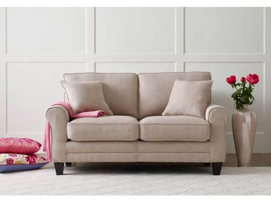 Standard beige love seat with two throw pillows.