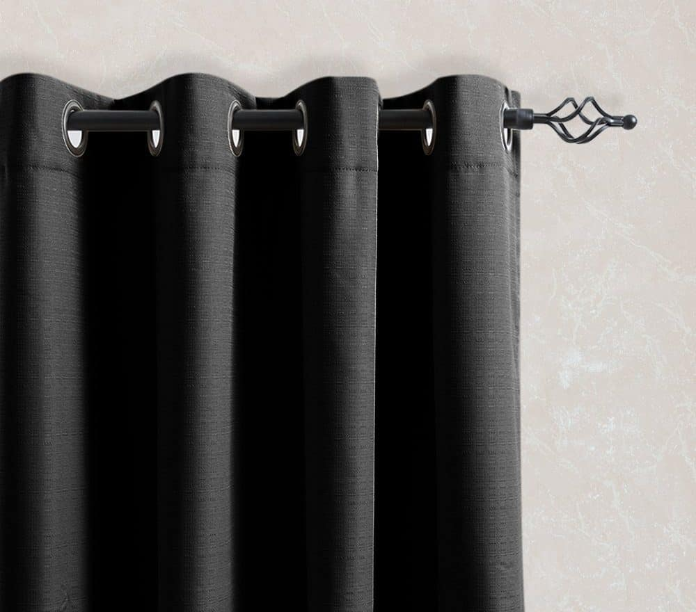 Black window curtain with thermal back feature.