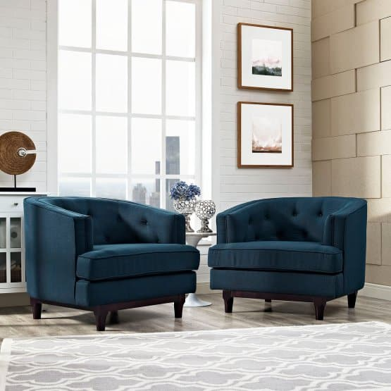 Blue arm chairs with double cushion seats and walnut-stained rubberwood legs.