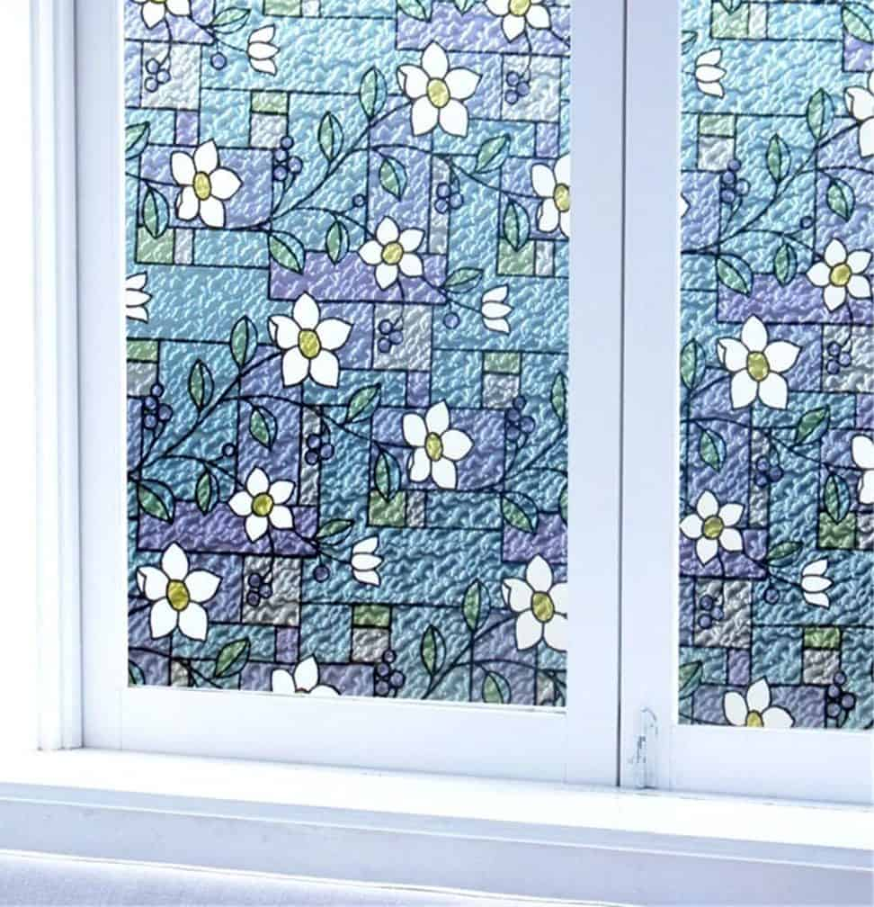Blue, decorative stained glass with floral designs.