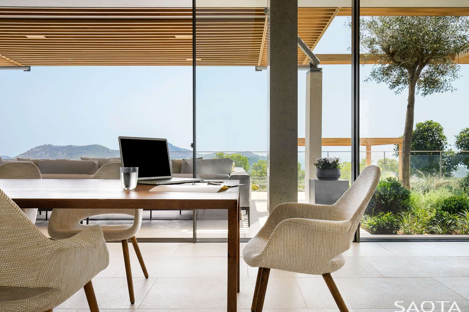 The dining area overlooks the beautiful view of Port d'Andratx. Photo by Adam Letch / Architecture by Rys Architects / Interior design by ARRCC and Rys Architects / Lighting design by Lux Populi / Landscaping by Cracknell