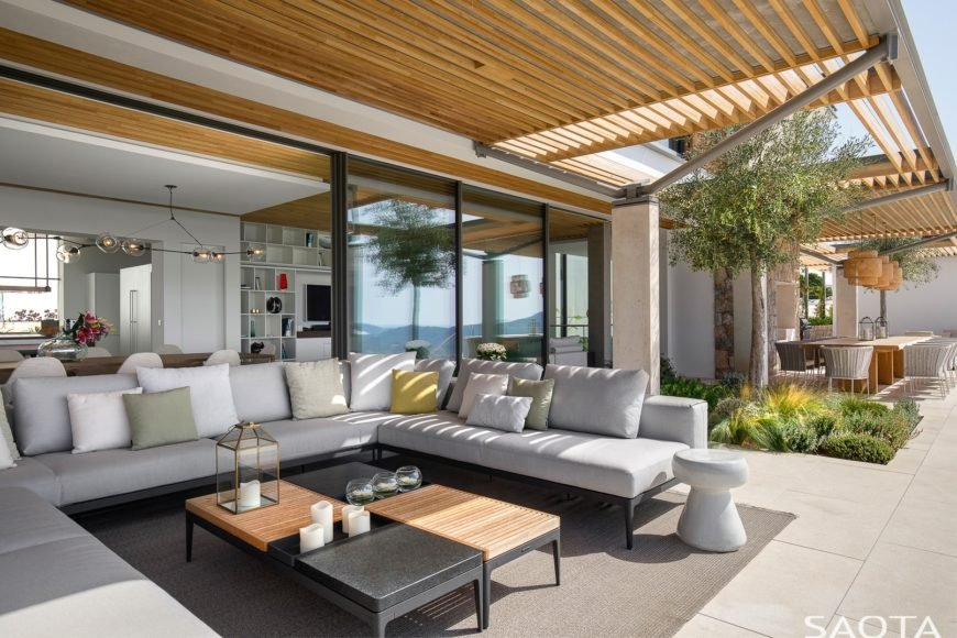 Classy patio area featuring a stylish center table and a comfy sofa set.