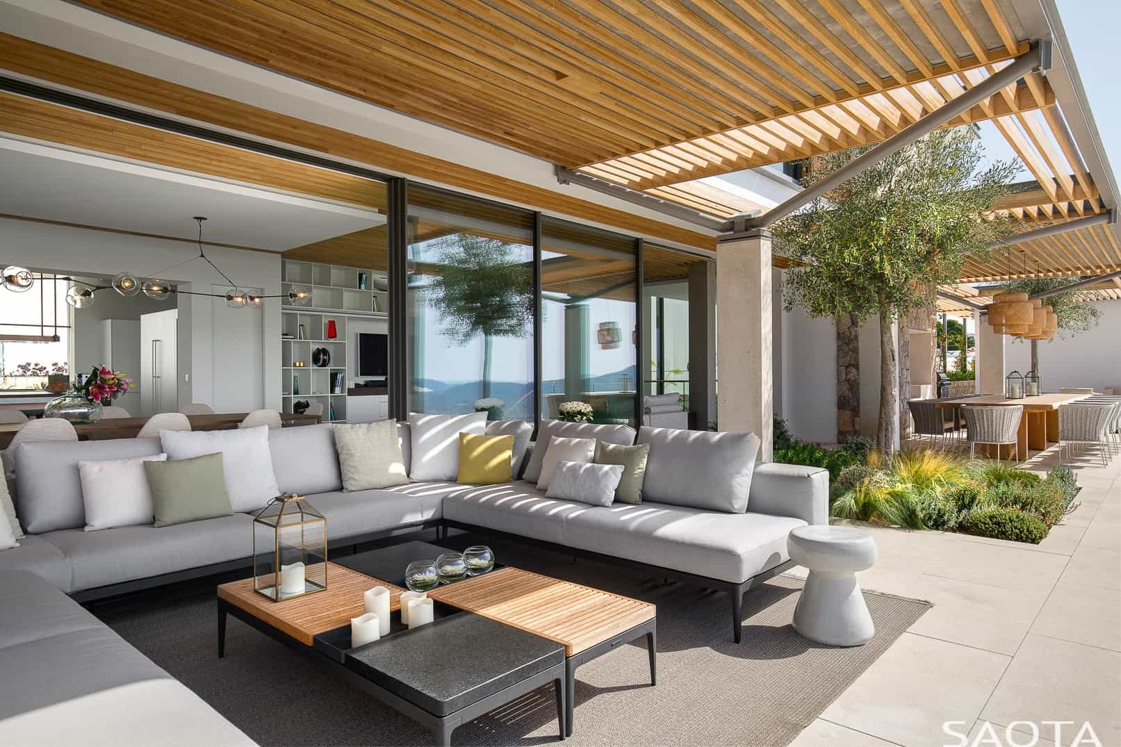 The patio maximises the luxurious outdoor living experience. Photo by Adam Letch / Architecture by Rys Architects / Interior design by ARRCC and Rys Architects / Lighting design by Lux Populi / Landscaping by Cracknell