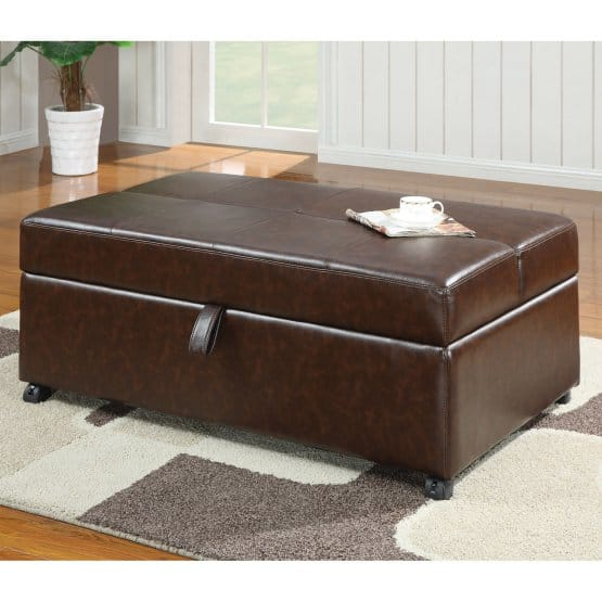 A traditional ottoman in faux leather and strap for opening.
