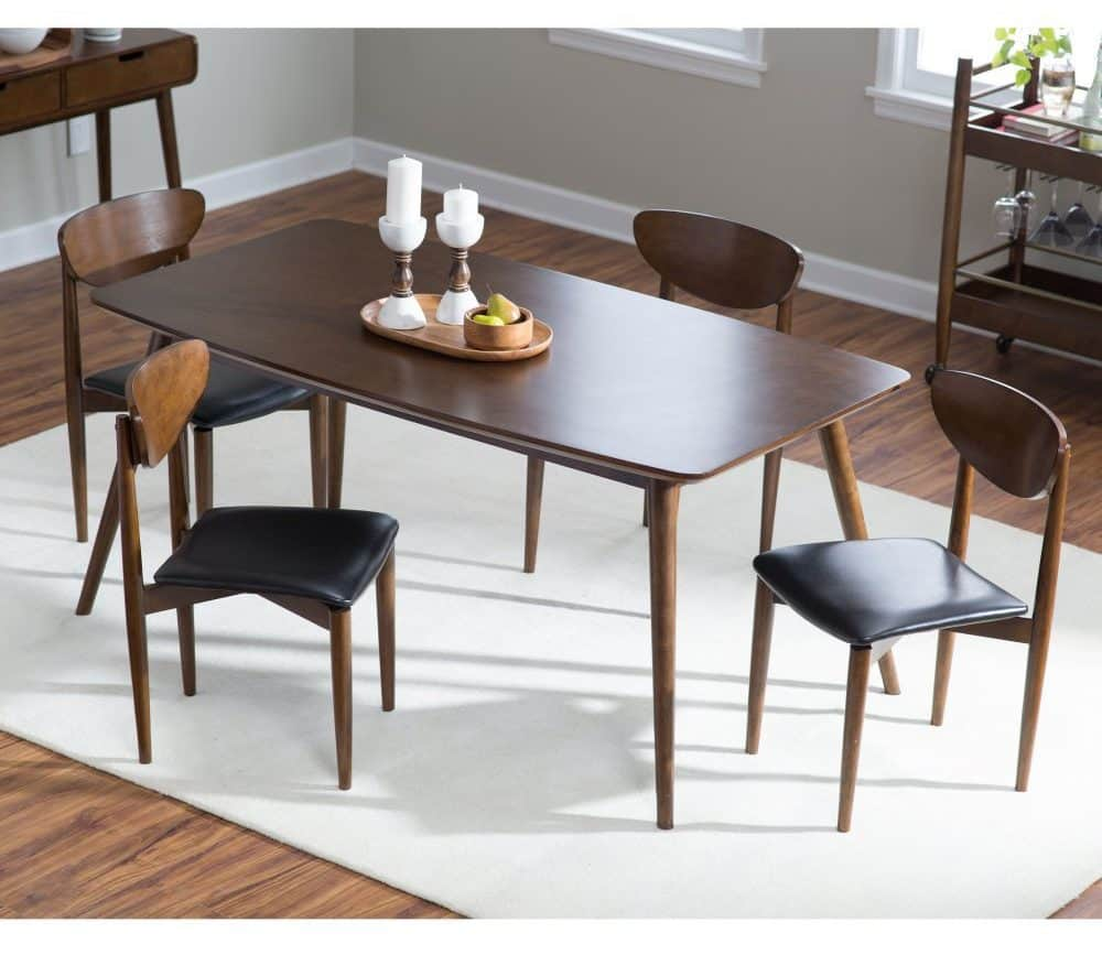 Smooth, wooden dining table with four seats which can be used as a place to iron clothing.