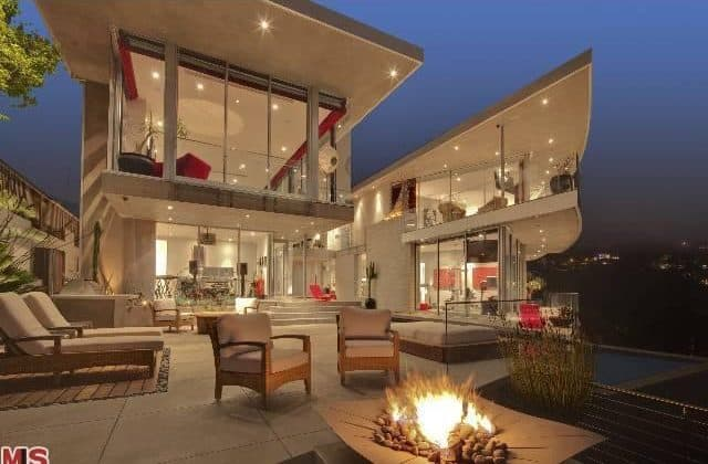 Outdoor living space offers a fire pit and nice set of seats.