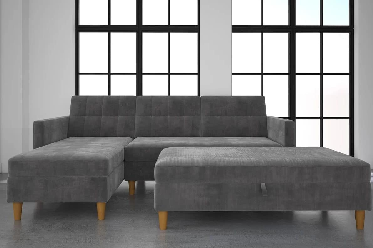 Sleeper sectional with ottoman and under-seat-storage.
