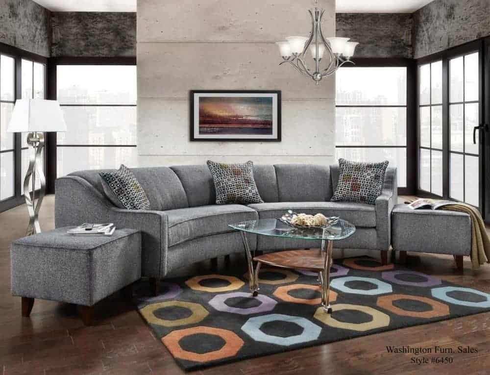 Sectional sofa with modern track arms and removable seat cushion.