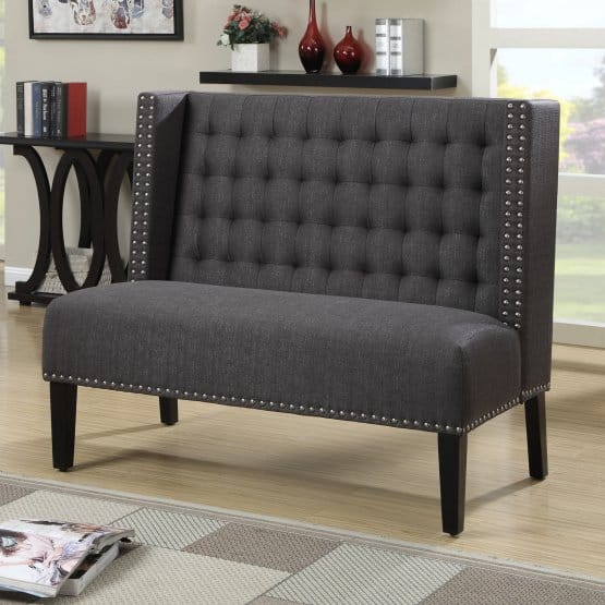 Dark gray banquette with a high bacrkrest.