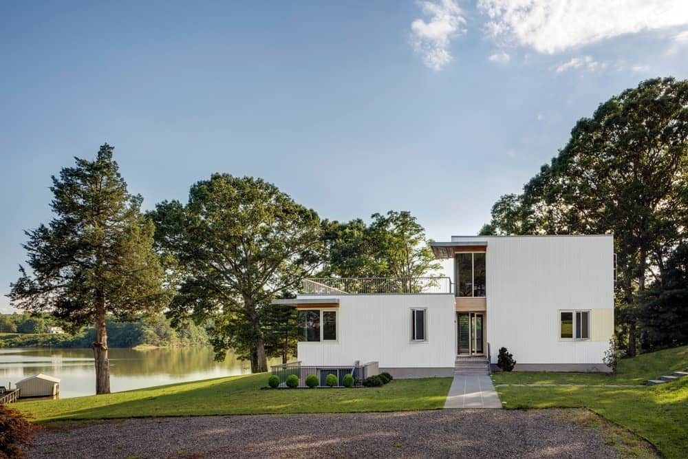 A view of the house from the side featuring the beautiful lawn and mature trees. Photo Credit: Francis Dzikowski/OTTO