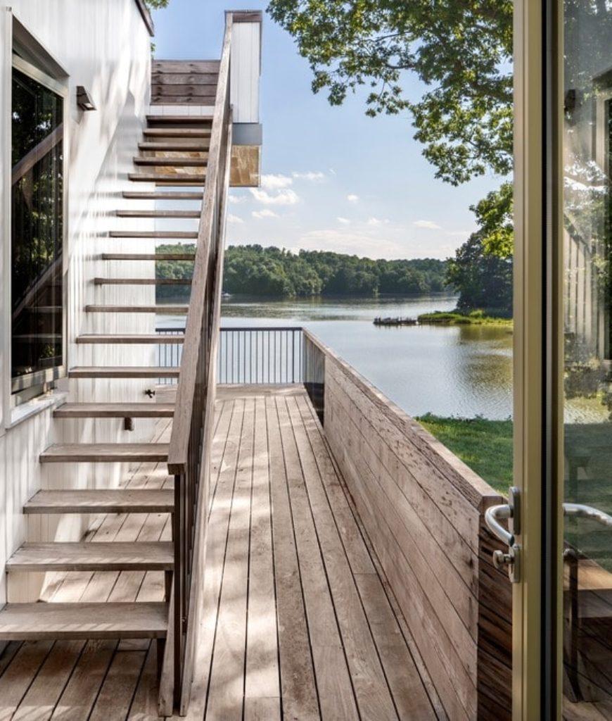 Staircase with hardwood flooring and hand rail. Photo Credit: Francis Dzikowski/OTTO