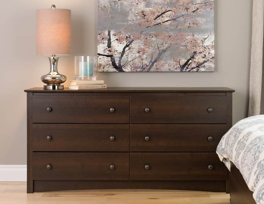 A large dresser in the bedroom.
