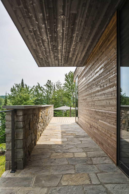 The house also boasts a hallway with brick flooring. Photo Credit: Ulysse Lemerise Bouchard