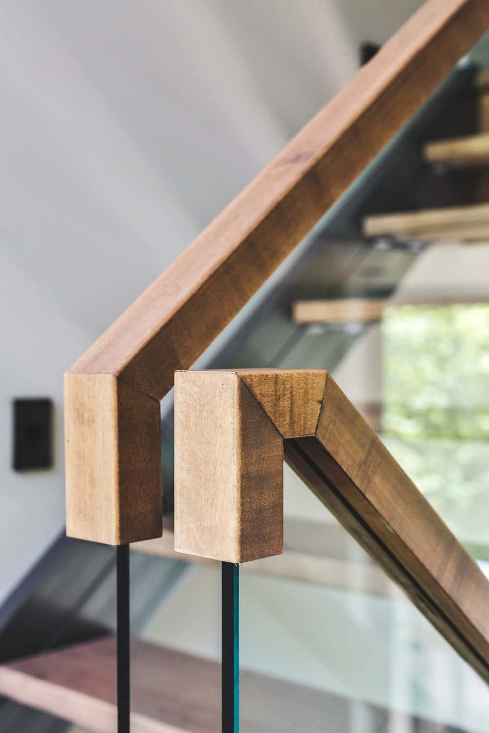 Another shot at the staircase focusing on hardwood handrail. Photo Credit: Ulysse Lemerise Bouchard