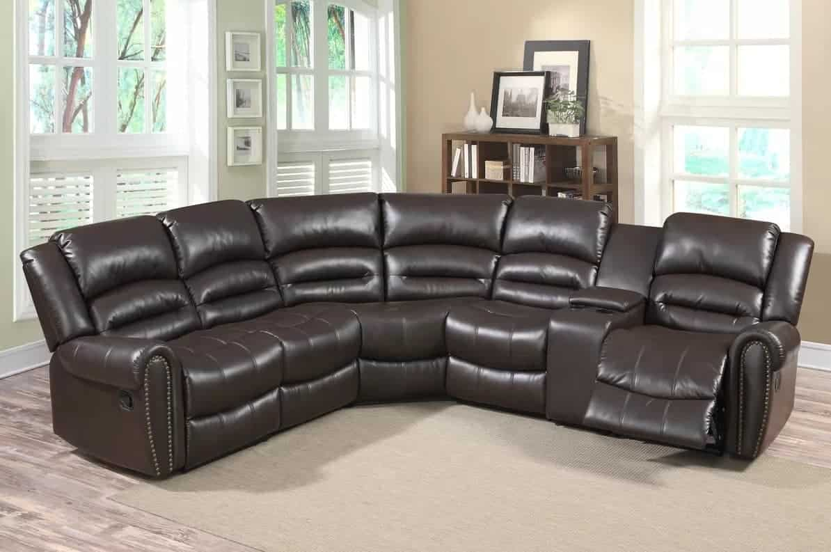 Reversible reclining sectional sofa with round arms and camel back.