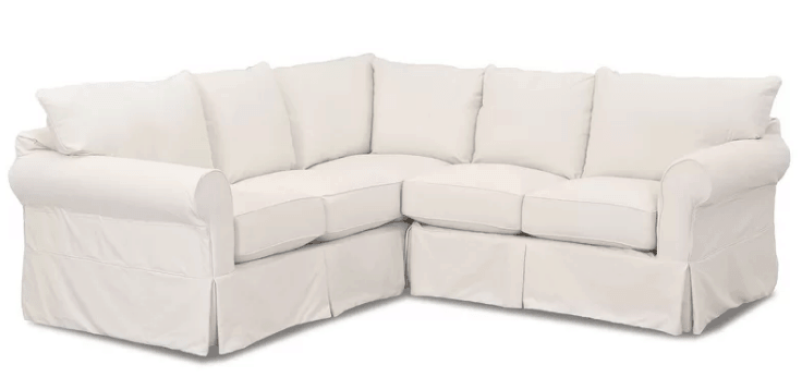 Felicity sectional sofa with round arms and pillow back.