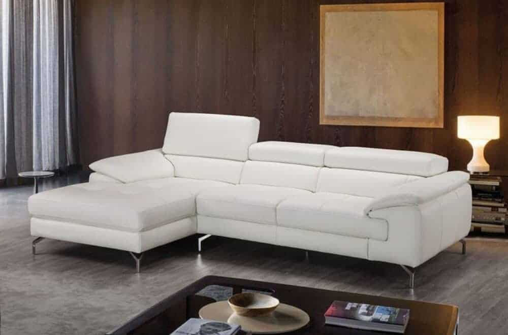 Crisp white leather sectional sofa with thick Italian leather upholstery and stainless steel legs.