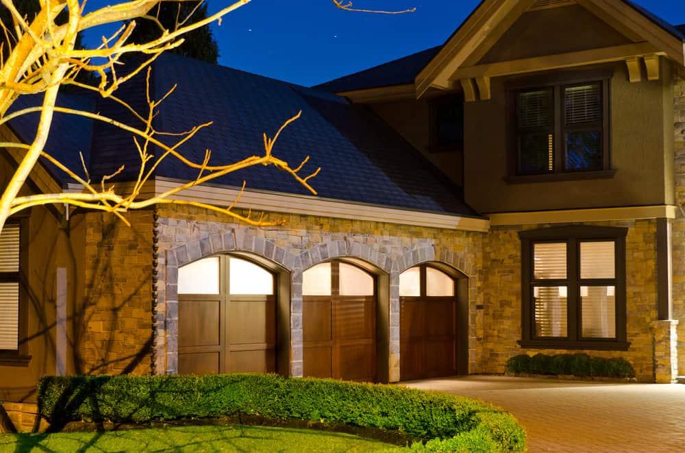 Garage door with upper arched windows