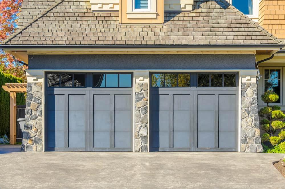 Garage door with continuous window band along top of garage door