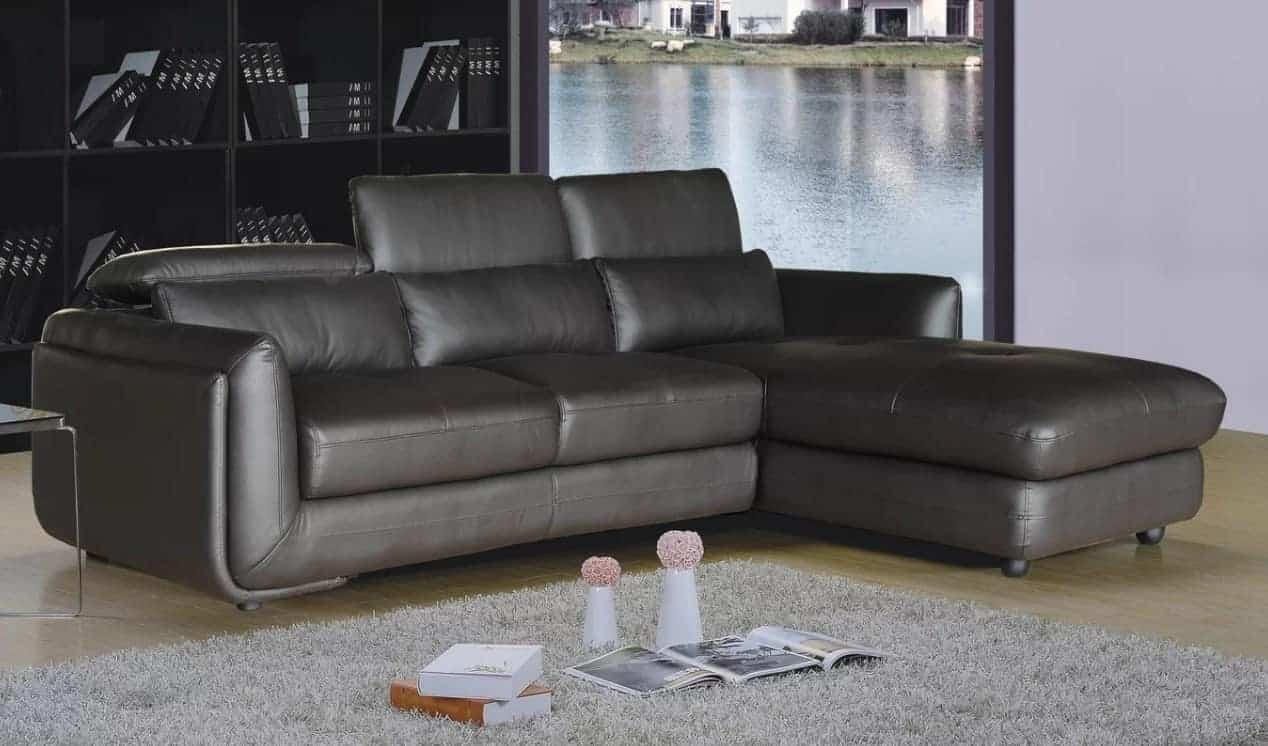 Leather sectional sofa with genuine leather upholstery and pillow top arms.